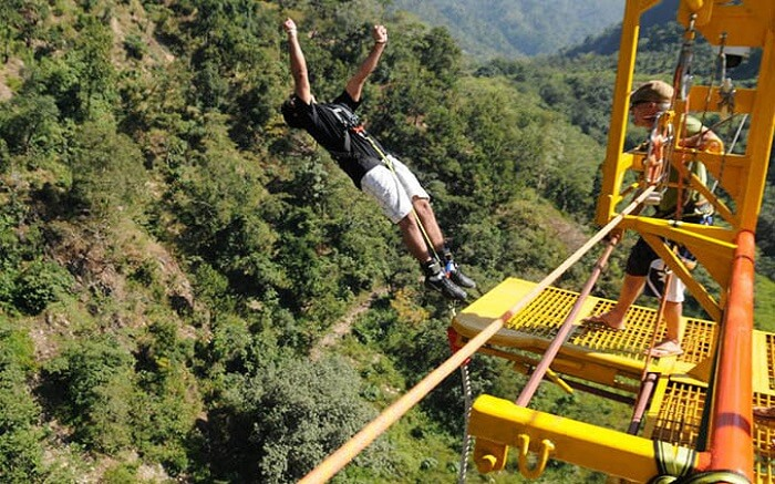 A boy in Black T-shirt Bungee Jumping in Rishikesh