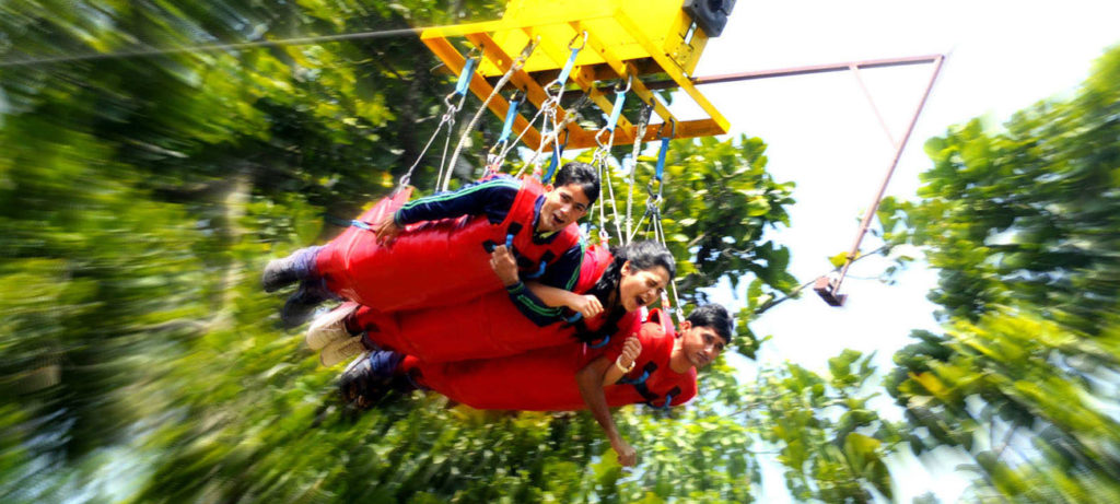three people in a group doing Flying Fox , a activity by India Thrills