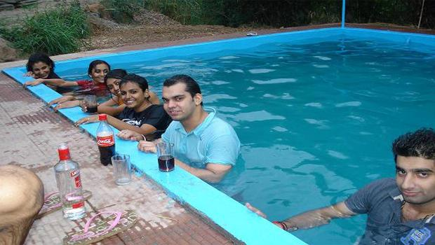 People chilling in Swimming pool at Indiathrills Campsite