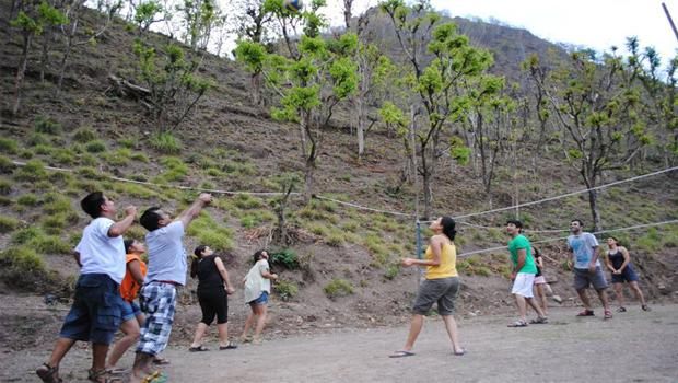 Group playing volleyball in Indiathrills campsite