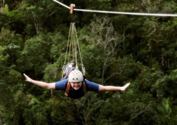 A girl doing Flying Fox, a India thrill activity