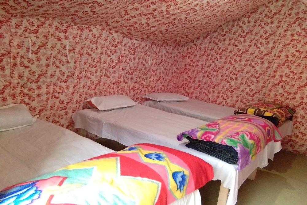 Inside view containing beds at India Thrill Camps
