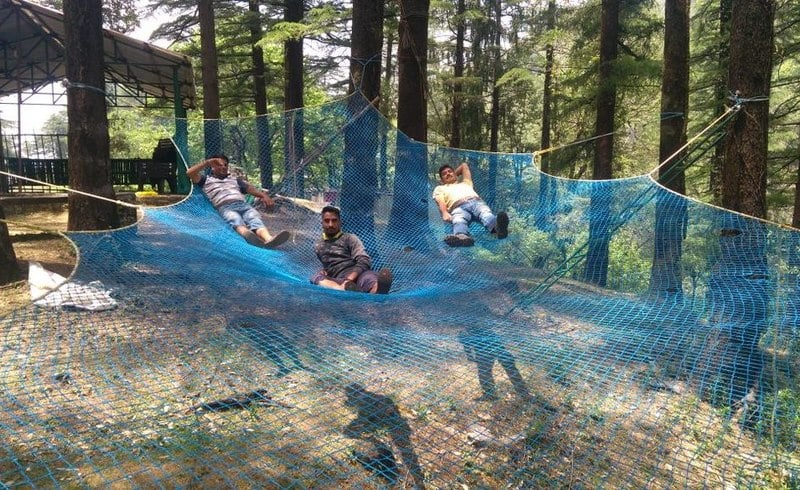 Three persons enjoying in Net Bridge at Northern Adventure Campsite